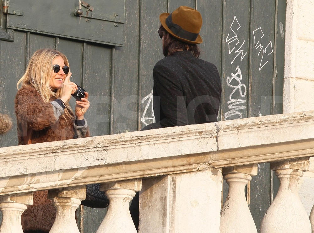 Sienna Miller snapped a candid of Tom Sturridge.