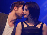 Robert Pattinson whispered into Kristen Stewart's ear while promoting New Moon in Germany in November 2009.