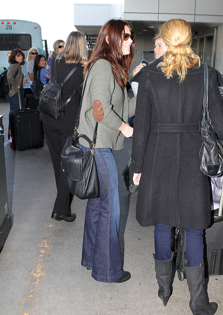 Ashley Greene had friends by her side at the airport.