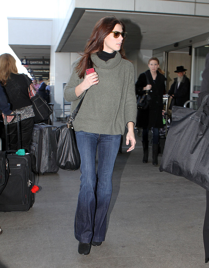 Ashley Greene stayed warm in a green sweater.