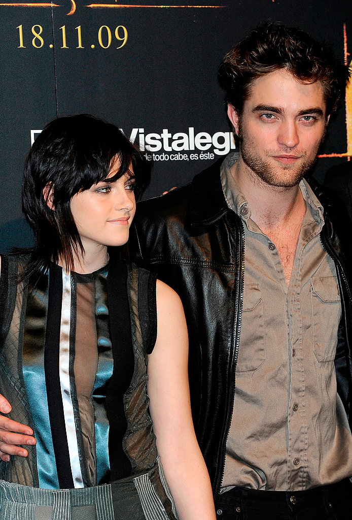 Robert Pattinson had his hand around Kristen Stewart's waist during a fan event in Spain in 2009.