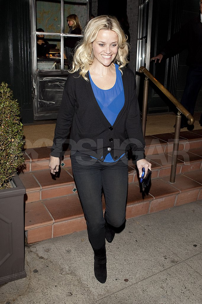 Reese Witherspoon in a blue sheer shirt leaving dinner with Cameron Diaz.