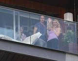 Britney Spears waved to fans with Jason Trawick on their hotel balcony.