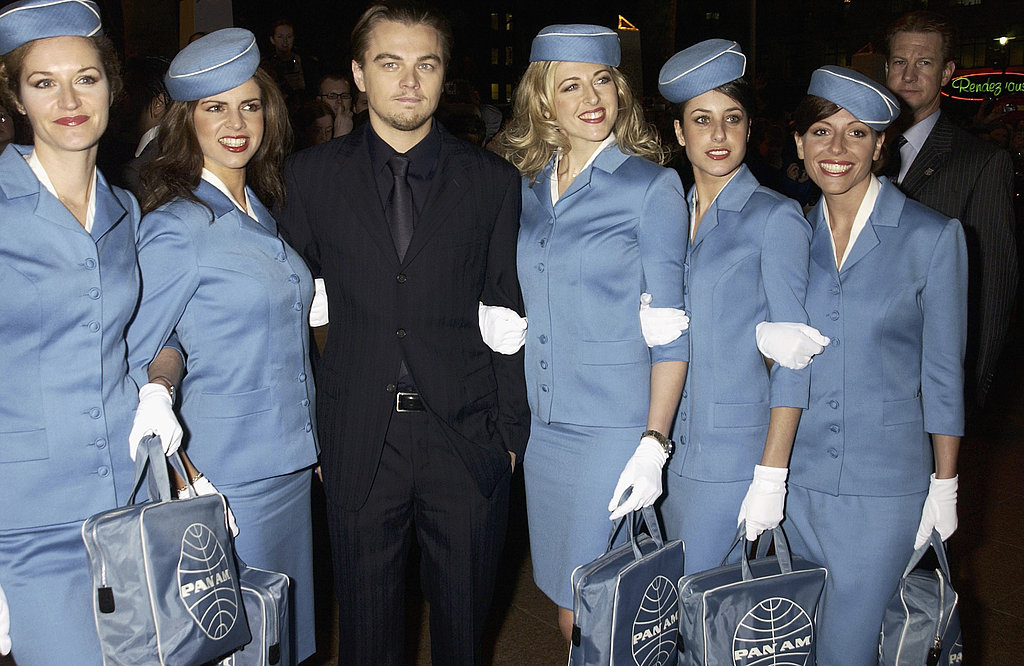 Leonardo DiCaprio stood with a gaggle of retro-chic flight attendants at the January 2003 UK premiere of Catch Me If You Can.