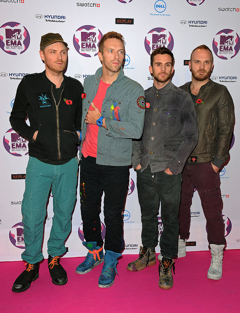 Chris Martin and the guys of Coldplay dressed in casual denim.
