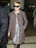 Michelle Williams stayed warm in comfortable and chic layers while flying into LA.