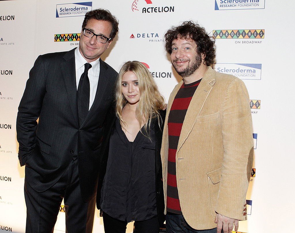 Ashley Olsen posing with comedians Bob Saget and Jeff Ross.