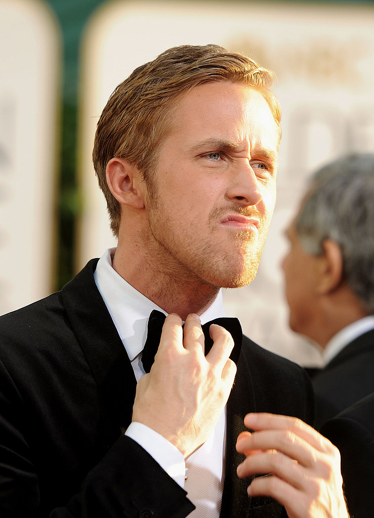 The actor looked sexy and silly while adjusting his bow tie on the Golden Globes red carpet in 2011.