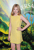 Chloe Moretz wore a pale yellow dress to the Versace for H&M presentation.