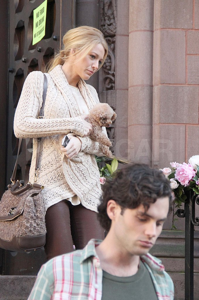Blake Lively and Penn Badgley film a scene for Gossip Girl.