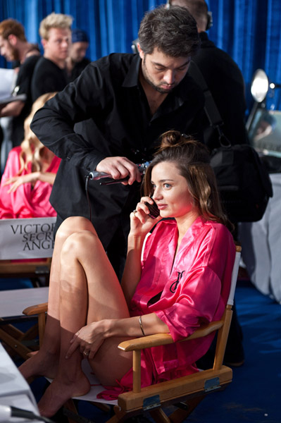 Miranda Kerr talked on her cell phone backstage at the Victoria's Secret Fashion Show.