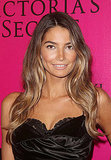 Lily Aldridge in a lacy black dress.