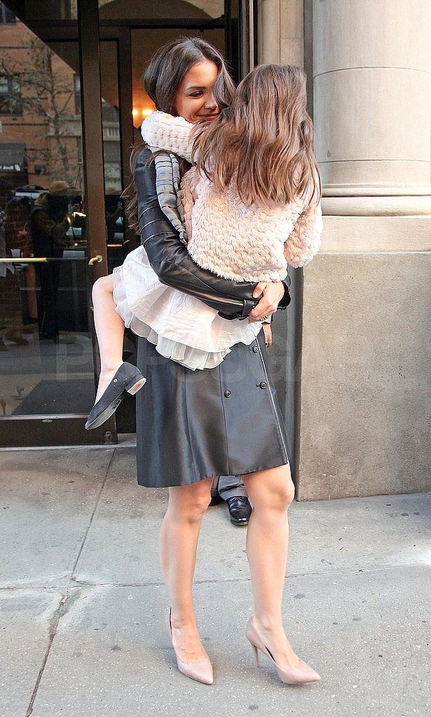 Suri held on tight to Katie.