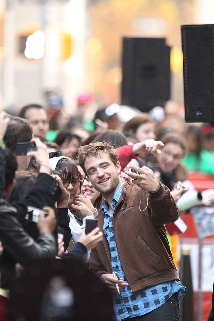 Robert Pattinson even took photos for his fans with their cameras.