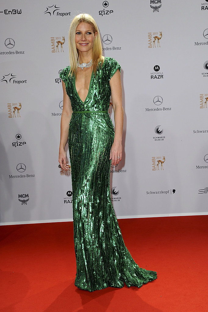 Gwyneth Paltrow posing in a green gown at the Bambi Awards.