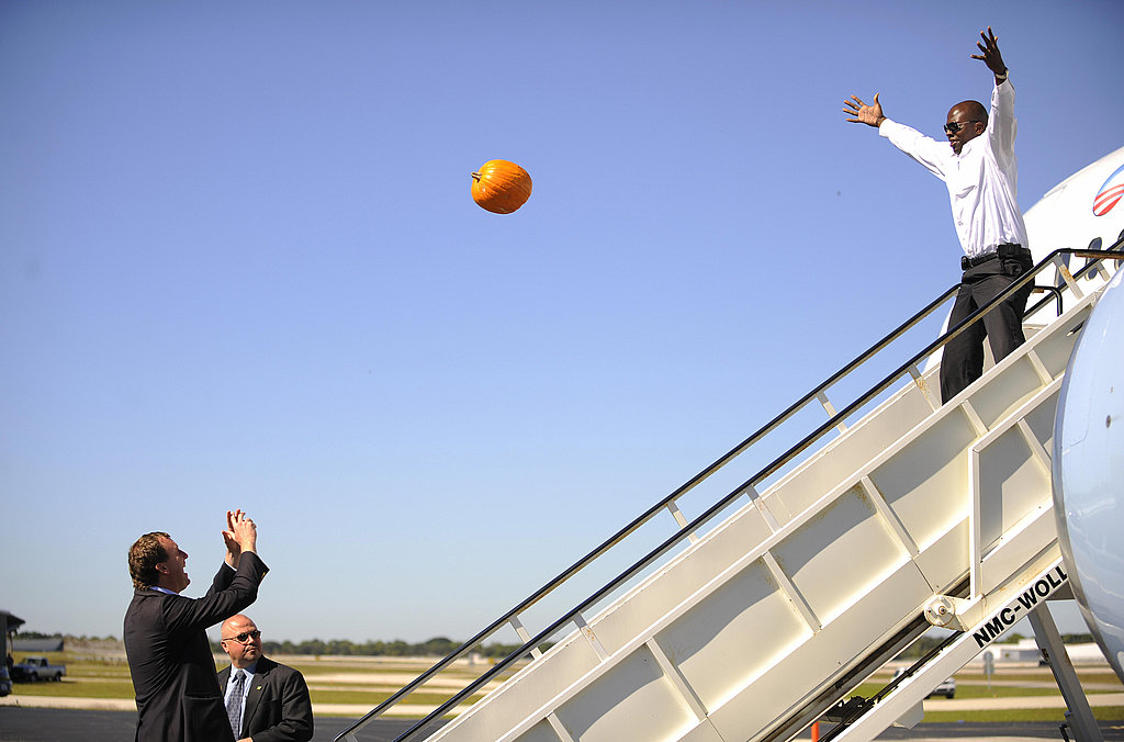 Reggie and an Obama campaign manager toss a pumpkin back and forth to each other before Halloween 2008.