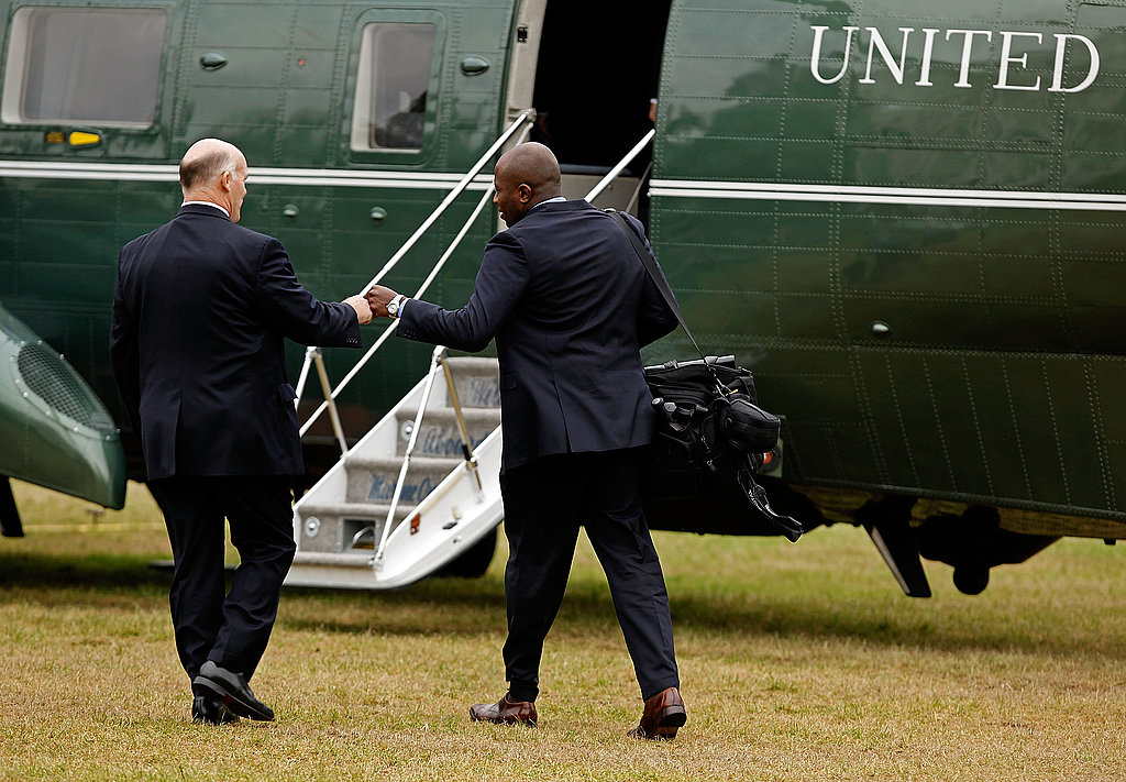 Reggie first bumps a member of the Secret Service.