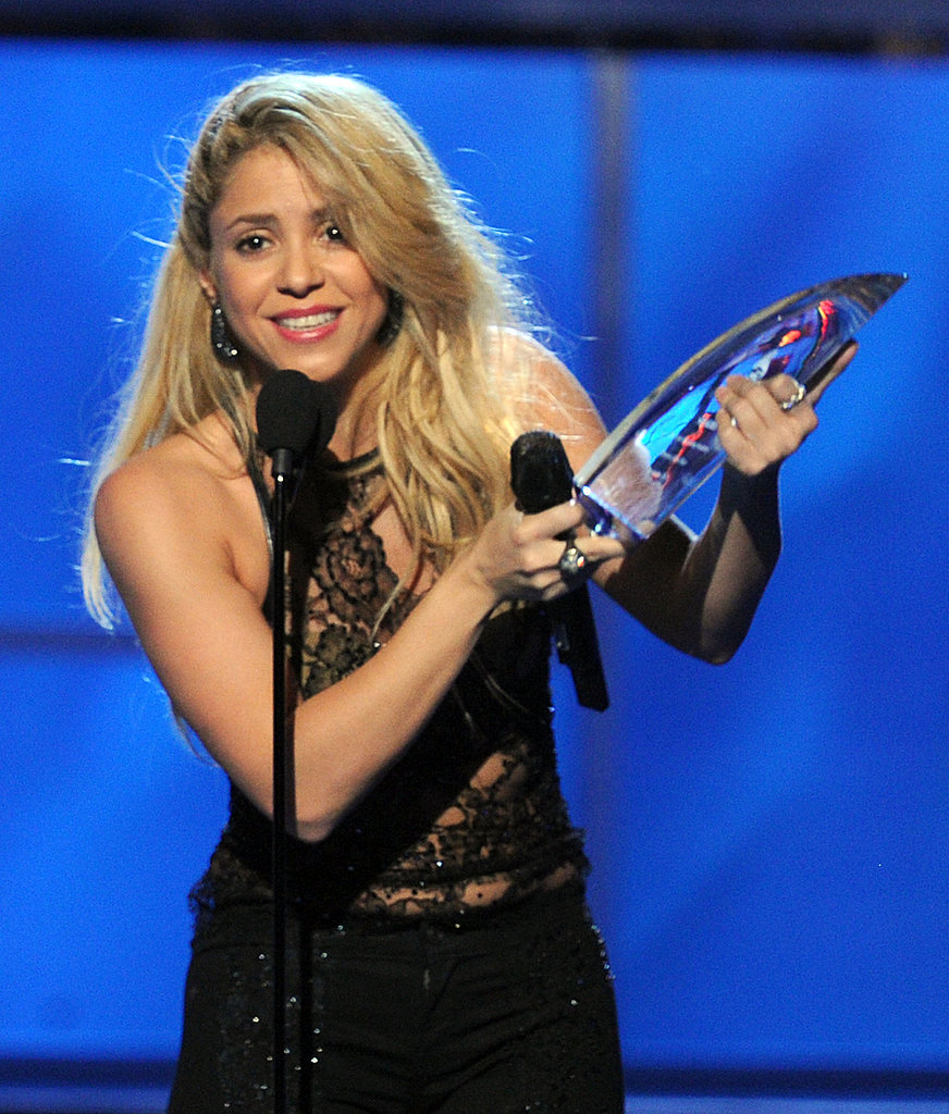 Shakira accepted an award at the 2011 Latin Grammys.
