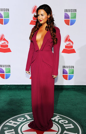 Demi Lovato in a maroon dress.
