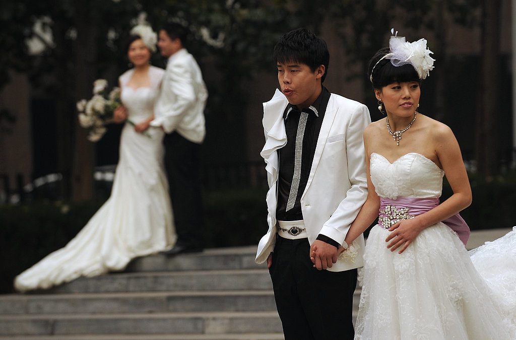 Couples pose for wedding photos in Beijing on November 11, 2011. Chinese couples flocked to registry offices to marry in the belief that the 11/11/11 date is the most lucky in a century.