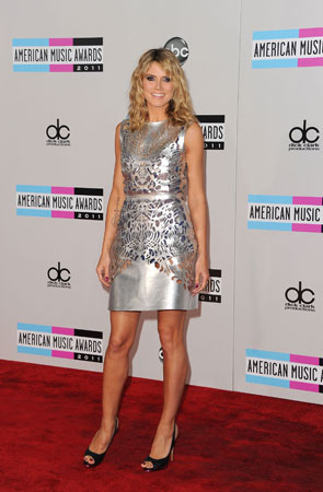 Heidi Klum wore a short silver dress.