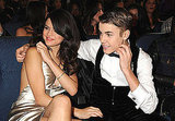 Justin Bieber cuddled up to Selena Gomez during the award show.