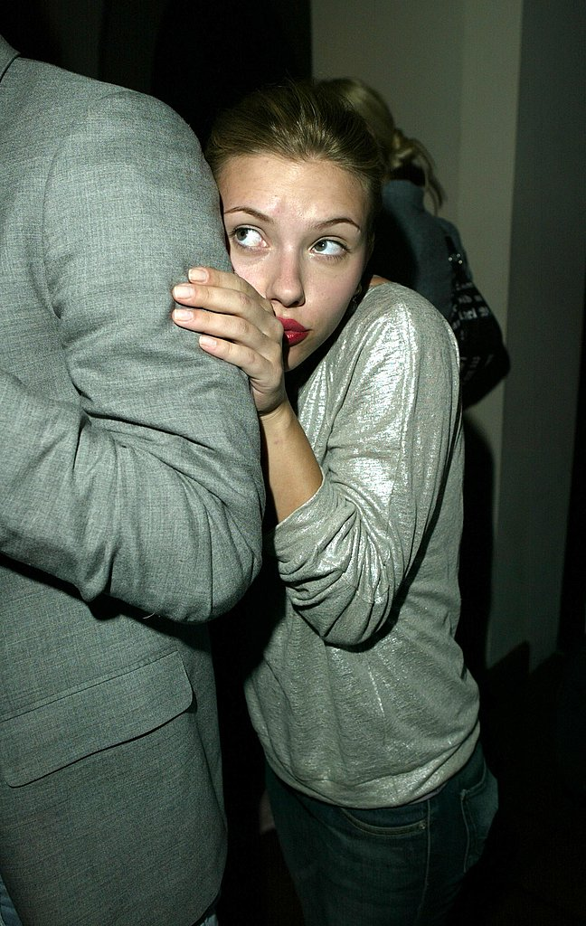 Scarlett Johansson playfully hid behind a friend at a party in 2004.