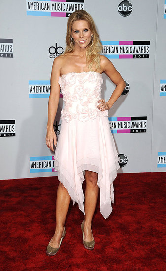 Cheryl Hines posed in a white dress.