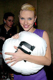 Scarlett Johansson hugged a giant M&M's pillow at an event in 2003.