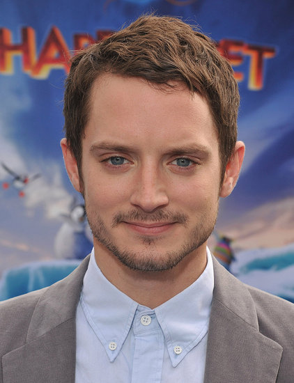 Elijah Wood gave a minismile at Grauman's Chinese Theatre.