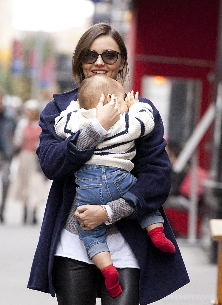 Miranda Kerr held onto Flynn Bloom.