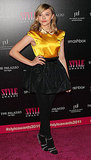 Chloe Moretz brightened up the pink carpet with her yellow top.