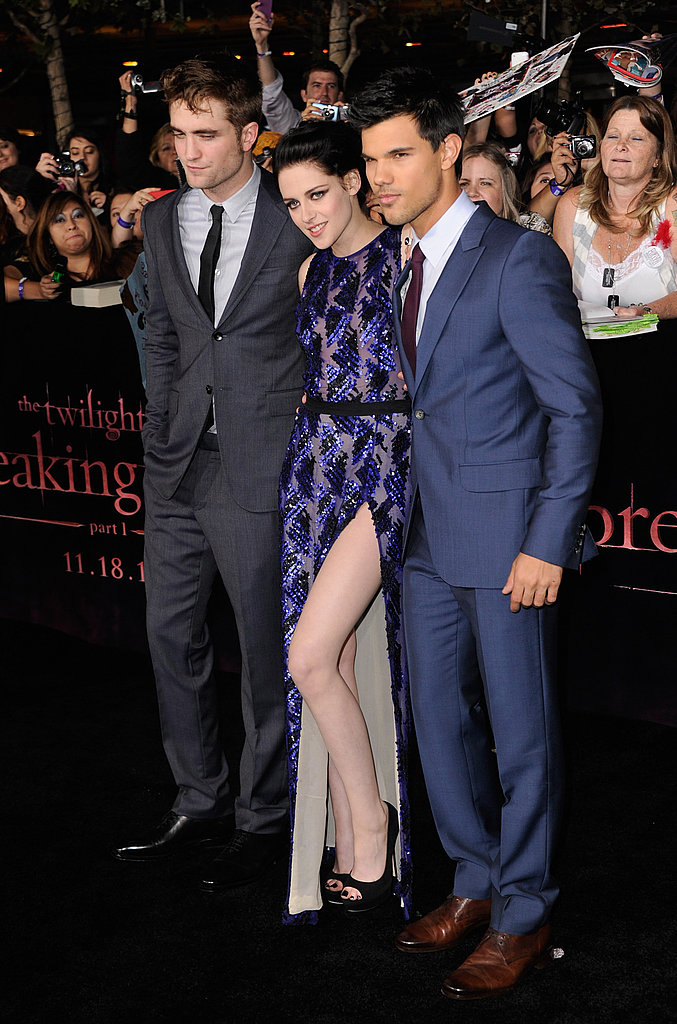Kristen's revealing dress gave a peek at both her legs.