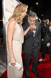 George Clooney gave Stacy Keibler a kiss on the red carpet.