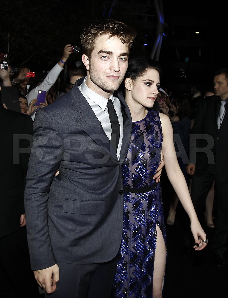 Robert Pattinson looked content with an arm around Kristen Stewart.