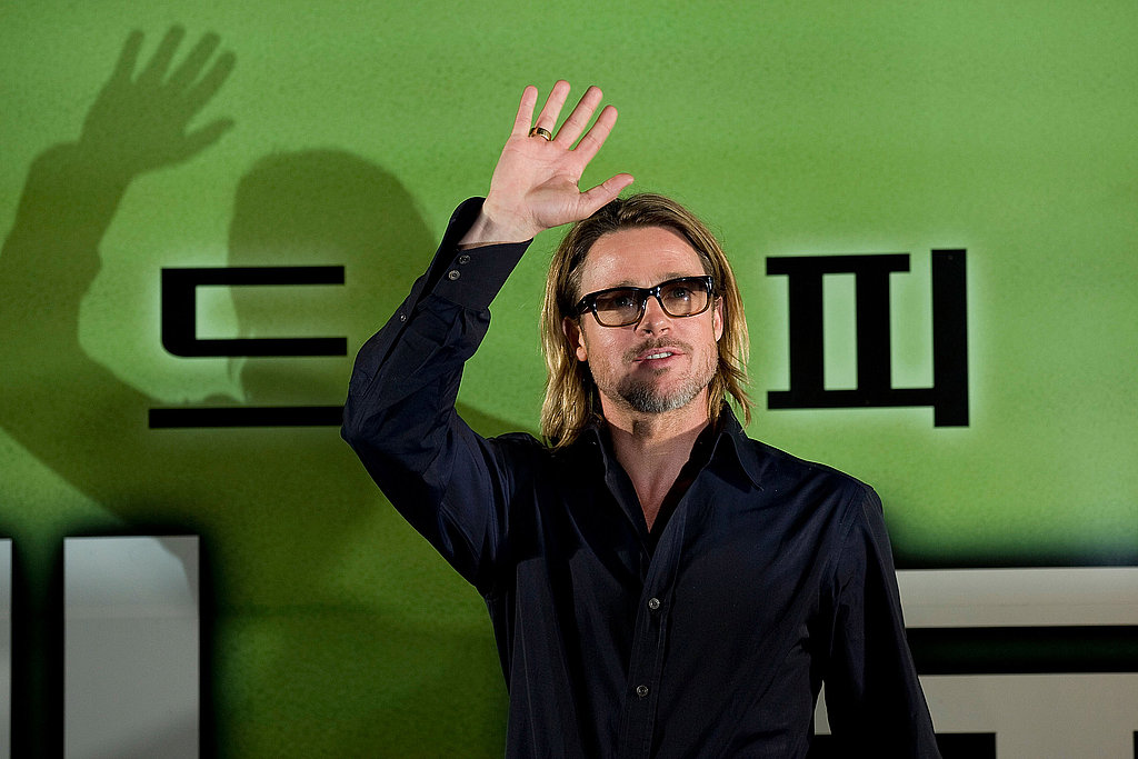 Brad Pitt waved while promoting Moneyball in South Korea.