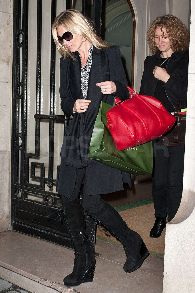 Kate Moss carried a purse and a Longchamp shopping bag.