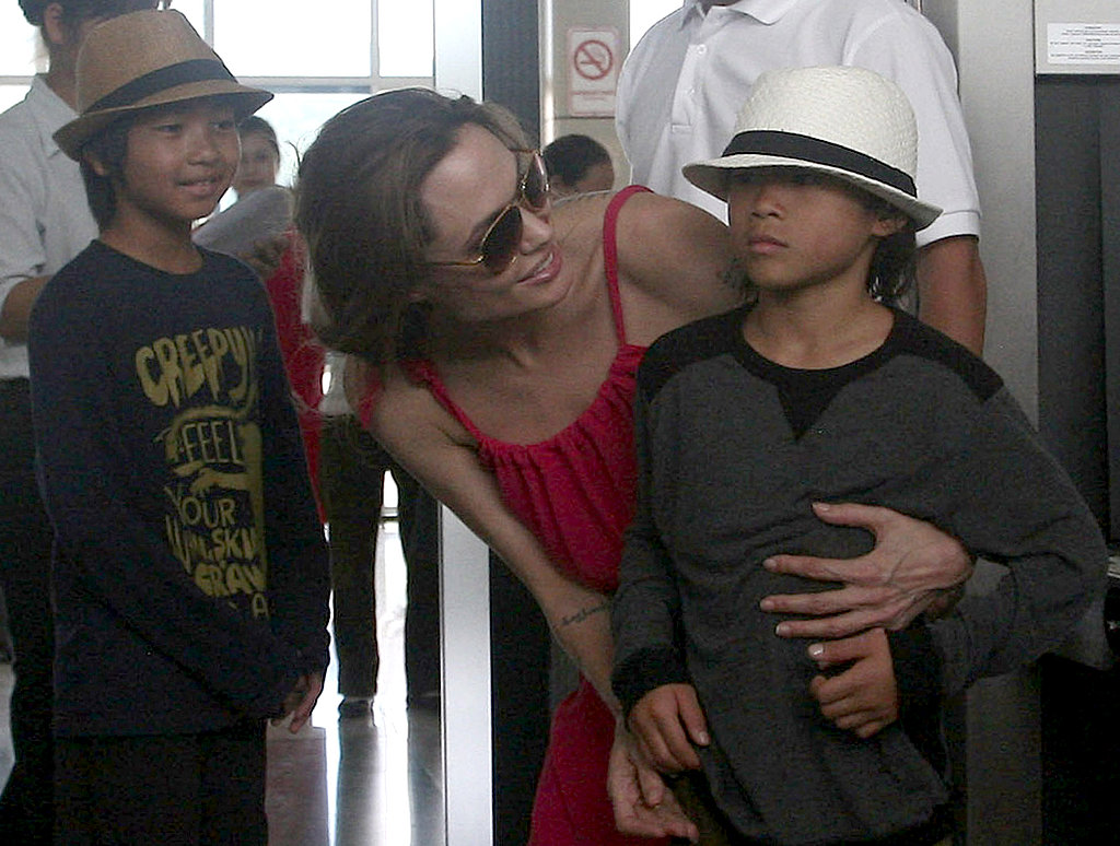 Maddox Jolie-Pitt smiled as Angelina Jolie checked on Pax Jolie-Pitt in Vietnam.