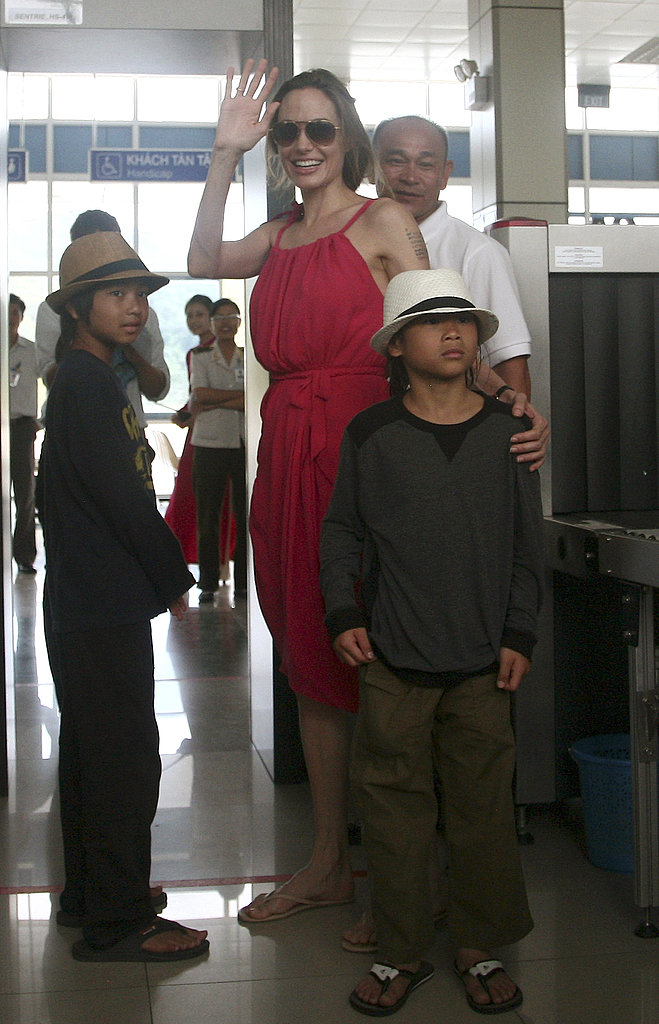 Maddox and Pax Jolie-Pitt wore matching hats at the Con Dao airport with Angelina Jolie.