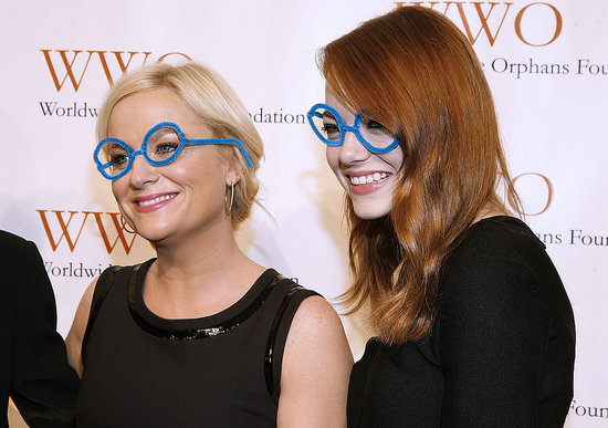 Amy Poehler and Emma Stone wore silly glasses at the Worldwide Orphans Foundation's Seventh Annual Benefit Gala in NYC on Nov. 14.