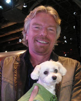 Lucky seems quite comfy in the arms of Richard Branson.