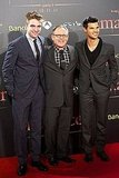 Robert Pattinson and Taylor Lautner with director Bill Condon in Barcelona.