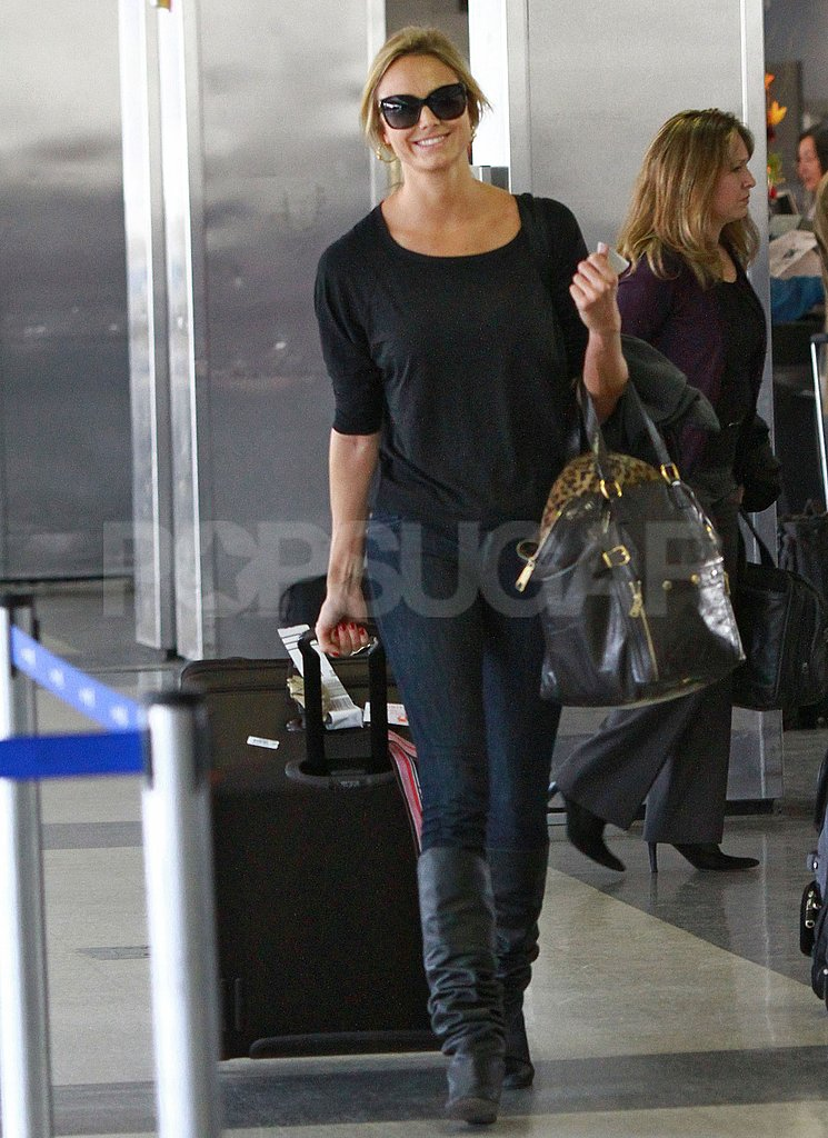 Stacy Keibler carried her own bags at LAX.