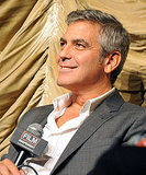 George Clooney looked handsome in a crisp white shirt.
