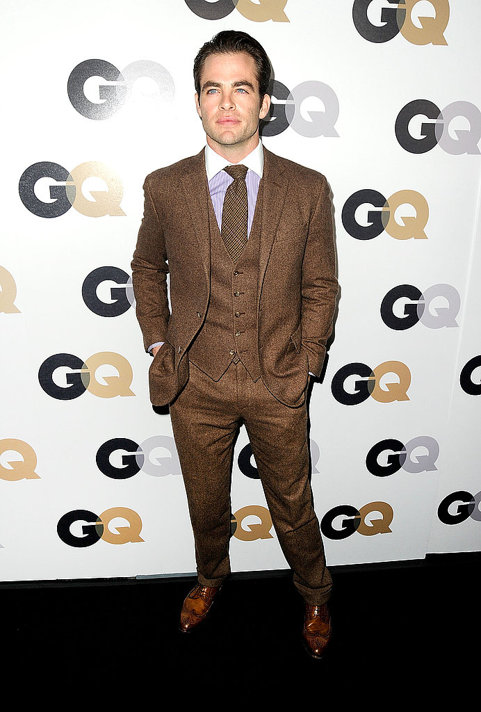 Chris Pine in a brown wool suit.