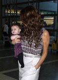 Victoria Beckham and Harper Beckham wore plaid and stripes at LAX.
