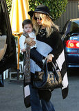 Rachel Zoe in a striped sweater with Skyler.