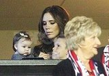 Cruz and Harper Beckham stayed close to their mom, Victoria.