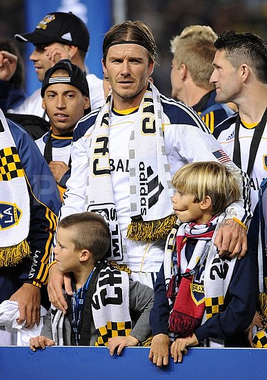 David Beckham posed with Romeo and Cruz.