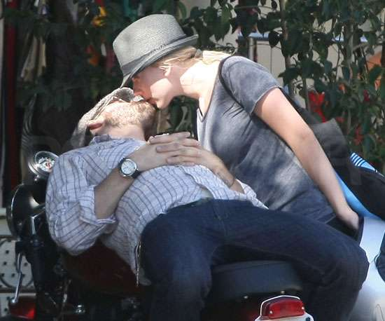 Scarlett Johansson and Ryan Reynolds shared a sexy smooch on a motorcycle in 2008.